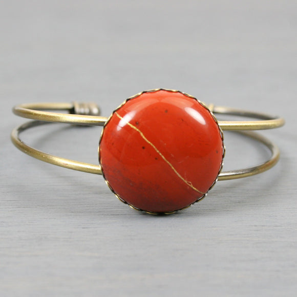 Red jasper kintsugi bracelet in an antiqued brass cuff bangle setting