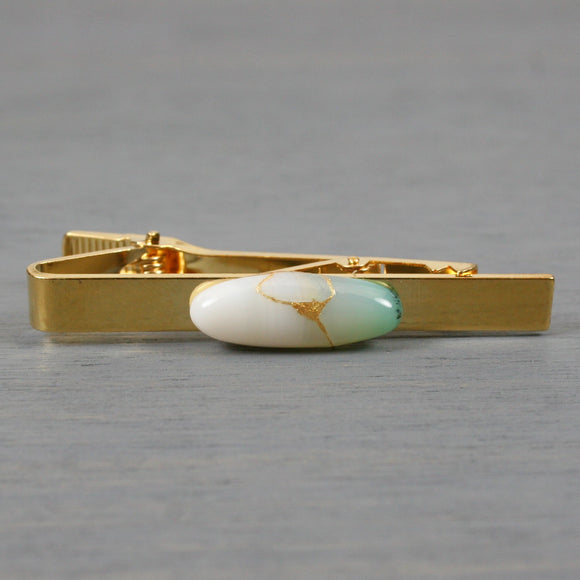 Green and white banded agate tie clip with kintsugi repair on gold plated bar