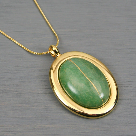 African jade kintsugi pendant in a gold setting on chain