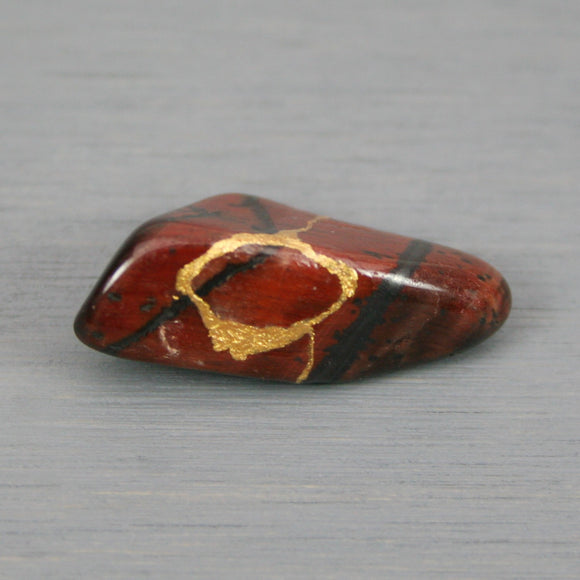 Small kintsugi repaired red tiger eye tumbled stone