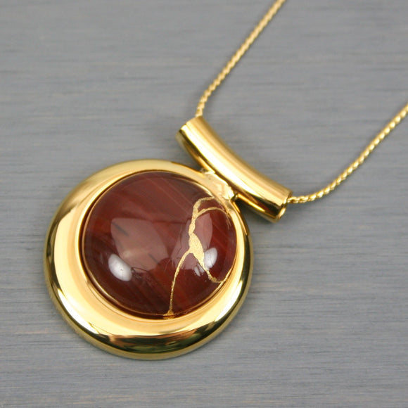 Carnelian kintsugi pendant in a gold setting on chain