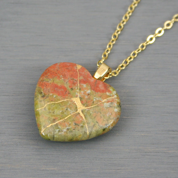 Unakite broken heart pendant with kintsugi repair on chain necklace