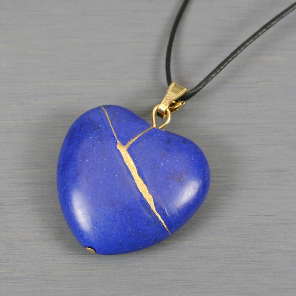 Blue howlite broken heart pendant with kintsugi repair on black cotton cord
