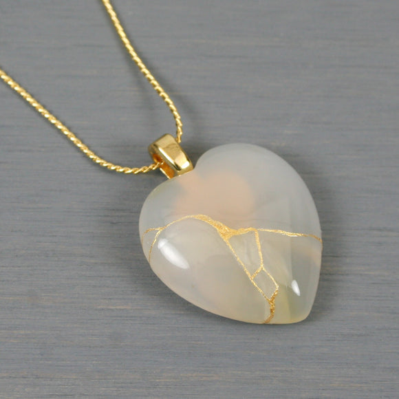 White agate broken heart pendant with kintsugi repair on chain necklace