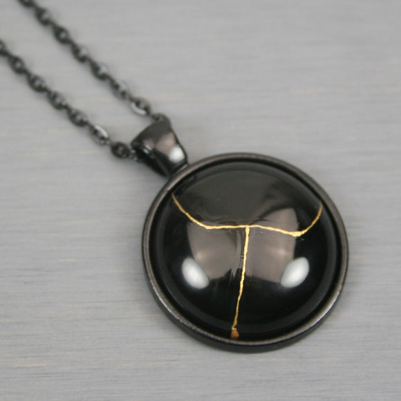 Black onyx kintsugi pendant in black setting on chain