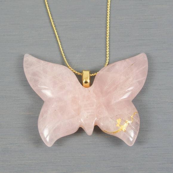 Rose quartz butterfly pendant with kintsugi repair on chain necklace