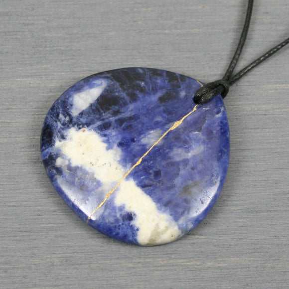 Sodalite pendant with kintsugi repair on black cotton cord