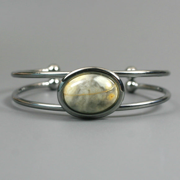 Yellow crazy lace agate kintsugi bracelet in a gunmetal cuff setting