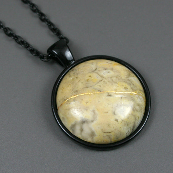 Crazy lace agate kintsugi pendant in black setting on chain from A Kintsugi Life