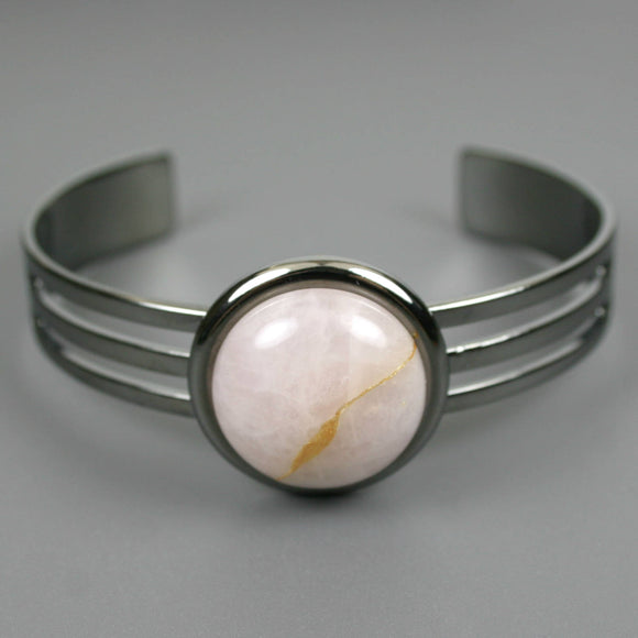 Rose quartz kintsugi bracelet in a gunmetal cuff setting from A Kintsugi Life