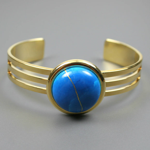 Turquoise howlite kintsugi bracelet with a gold cuff setting from A Kintsugi Life