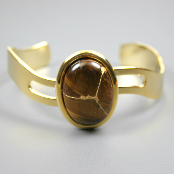 Tiger eye kintsugi bracelet in a gold cuff setting from A Kintsugi Life