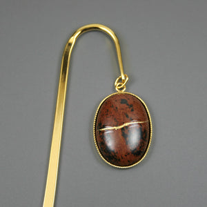 Mahogany obsidian with kintsugi repair on gold plated steel bookmark from A Kintsugi Life