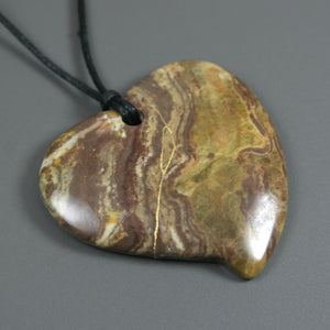Brown ocean jasper broken heart pendant with kintsugi repair on black cotton cord from A Kintsugi Life