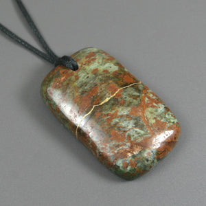 Brown crazy lace agate pendant with kintsugi repair on black cotton cord from A Kintsugi Life