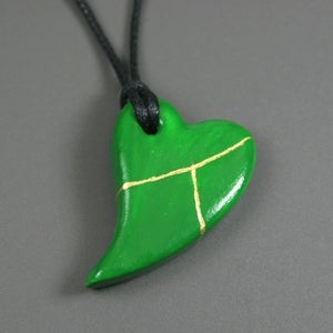 Green faux kintsugi broken heart pendant on black cotton cord from A Kintsugi Life
