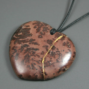 Brown jasper broken heart pendant with kintsugi repair on black cotton cord from A Kintsugi Life
