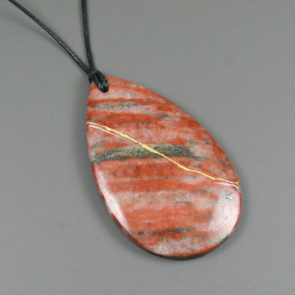 Rainbow jasper pendant with kintsugi repair on black cotton cord from A Kintsugi Life
