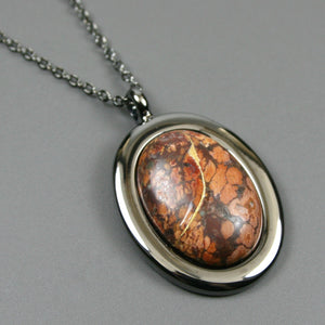Leopardskin jasper kintsugi pendant in a gunmetal setting on chain from A Kintsugi Life