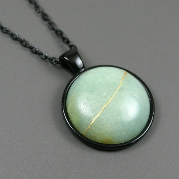 Amazonite kintsugi pendant in black setting on chain from A Kintsugi Life