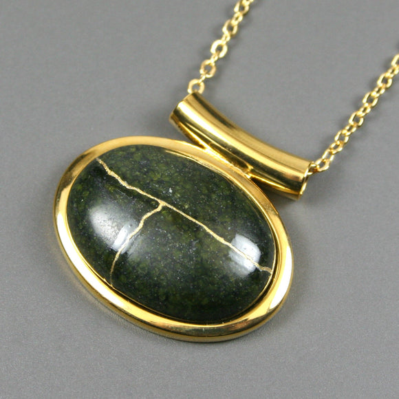 Russian serpentine kintsugi pendant in a gold setting on chain from A Kintsugi Life