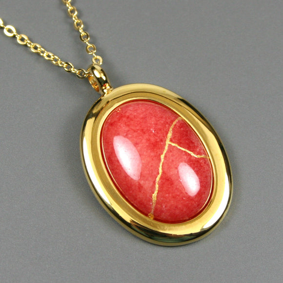 Coral dolomite kintsugi pendant in a gold setting on chain from A Kintsugi Life