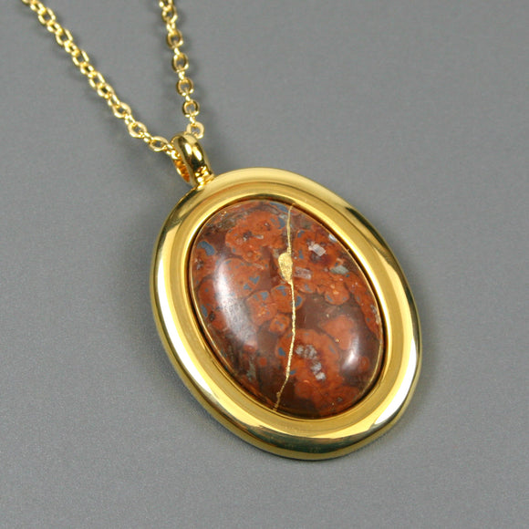 Leopardskin jasper kintsugi pendant in a gold setting on chain from A Kintsugi Life