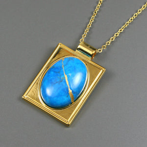Turquoise howlite kintsugi pendant in a gold setting on chain from A Kintsugi Life