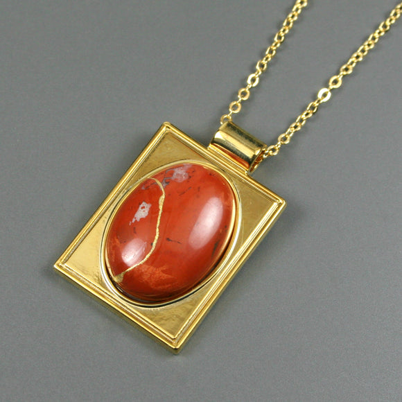 Red jasper kintsugi pendant in a gold setting on chain from A Kintsugi Life