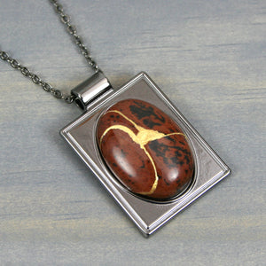 Mahogany obsidian kintsugi pendant in a gunmetal setting on chain from A Kintsugi Life
