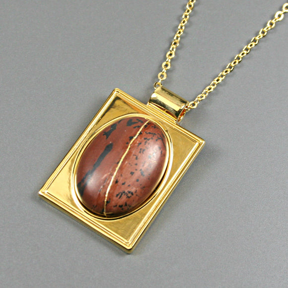 Mahogany obsidian kintsugi pendant in a gold setting on chain from A Kintsugi Life