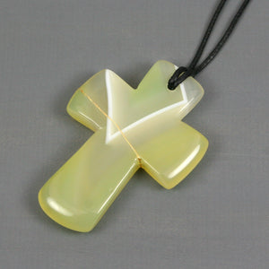Yellow banded agate kintsugi cross pendant on black cotton cord necklace from A Kintsugi Life