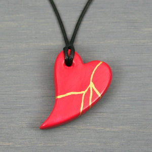 Red faux kintsugi broken heart pendant on black cotton cord from A Kintsugi Life
