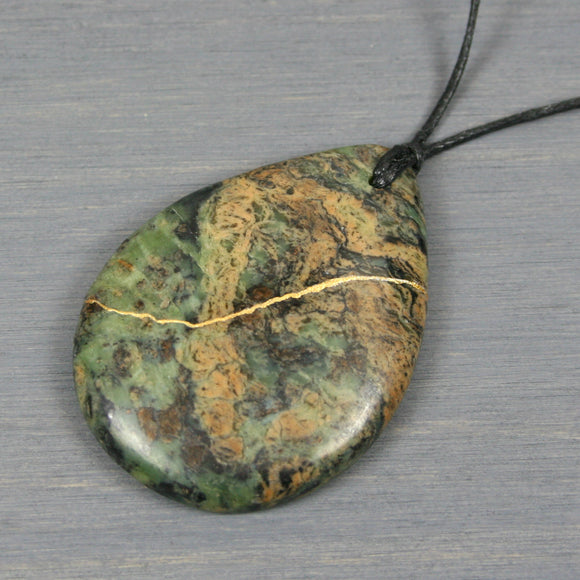 Green crazy lace agate teardrop pendant with kintsugi repair on black cotton cord from A Kintsugi Life