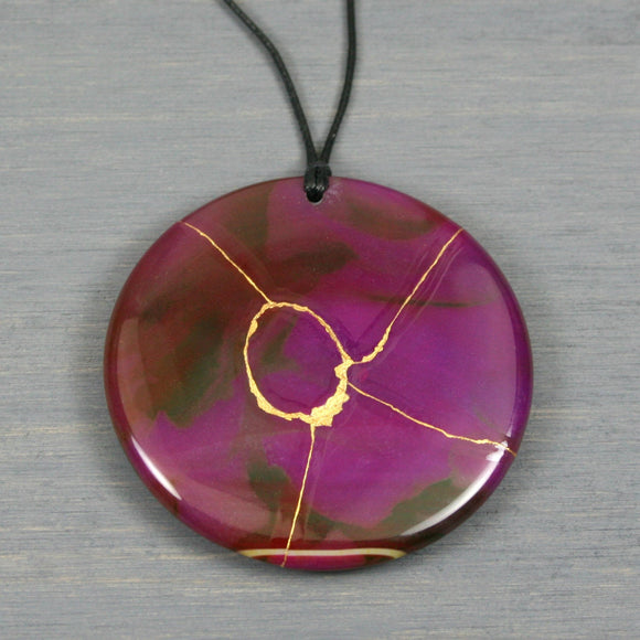 Large purple agate pendant with kintsugi repair on black cotton cord from A Kintsugi Life