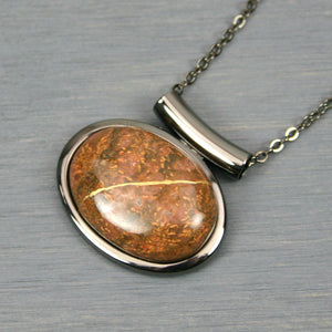 Chrysanthemum stone kintsugi pendant in a gunmetal setting on chain from A Kintsugi Life