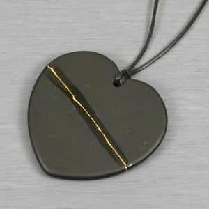 Black slate broken heart pendant with kintsugi repair on black cotton cord from A Kintsugi Life