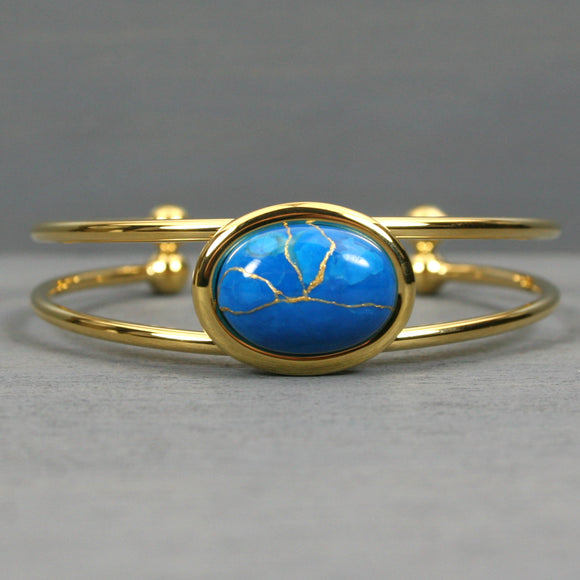 Turquoise howlite kintsugi bracelet in a gold cuff setting from A Kintsugi Life