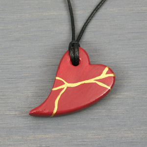 Dark red faux kintsugi broken heart pendant on black cotton cord from A Kintsugi Life