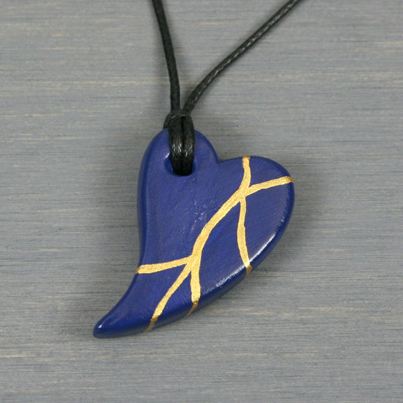 Dark blue faux kintsugi broken heart pendant on black cotton cord from A Kintsugi Life