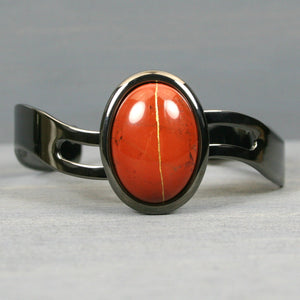 Red jasper kintsugi bracelet in a gunmetal cuff setting from A Kintsugi Life