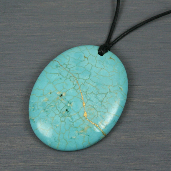 Turquoise howlite pendant with kintsugi repair on black cotton cord from A Kintsugi Life