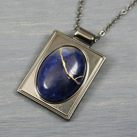 Sodalite kintsugi pendant in a gunmetal setting on chain from A Kintsugi Life