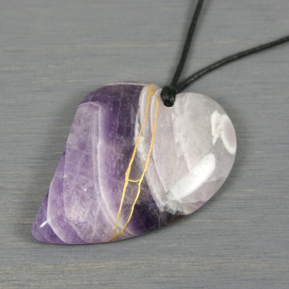 Amethyst broken heart pendant with kintsugi repair on black cotton cord from A Kintsugi Life