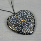 Black and white dragon veins agate broken heart pendant with kintsugi repair on black cotton cord from A Kintsugi Life