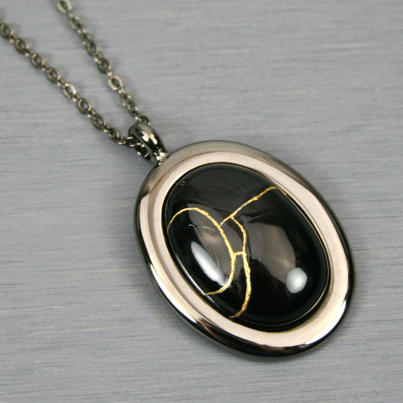 Black onyx kintsugi pendant in a gunmetal setting on chain from A Kintsugi Life
