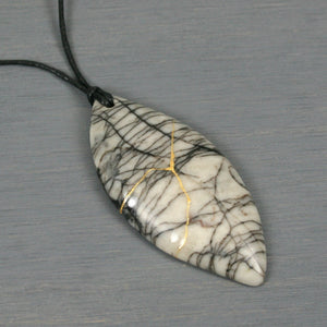 Black silk stone marquise pendant with kintsugi repair on black cotton cord from A Kintsugi Life
