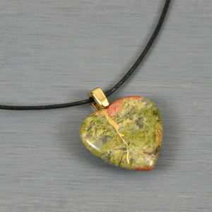 Unakite broken heart pendant with kintsugi repair on black cotton cord from A Kintsugi Life