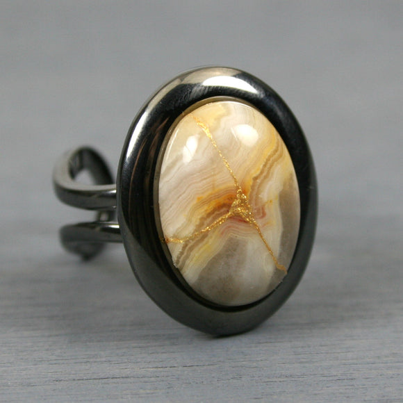 Yellow crazy lace agate kintsugi ring in a gunmetal plated adjustable setting from A Kintsugi Life