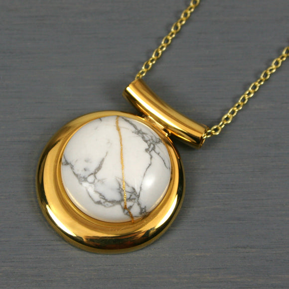 White howlite kintsugi pendant in a gold setting on chain from A Kintsugi Life
